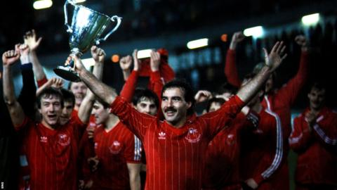 Captain Willie Miller gets his hands on the European Cup Winners' Cup trophy.