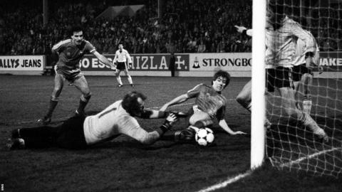 Mark McGhee forces the ball in from close range in the first leg of the semi-final against Waterschei.