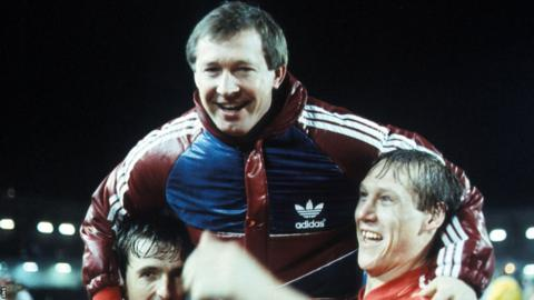 Dons manager Alex Ferguson joins in the celebrations at full-time.