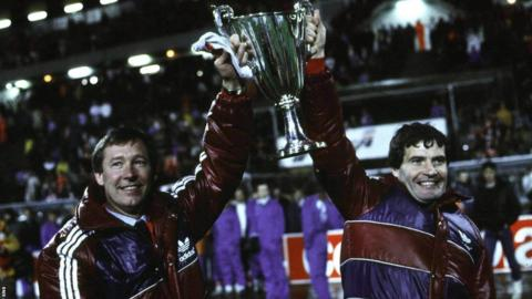Alex Ferguson and his assistant Archie Knox show off the cup - one of 10 trophies the pair brought to Pittodrie.