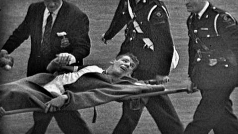 Dave Whelan being stretchered off in the 1960 FA Cup final