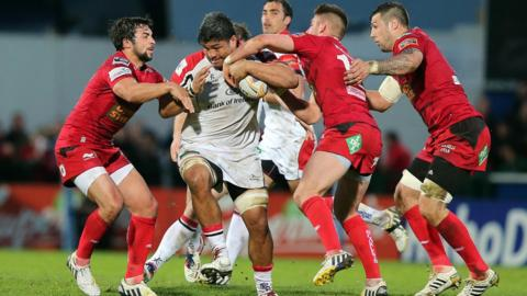 Rampaging Ulster number eight Nick Williams makes ground against the Scarlets defence