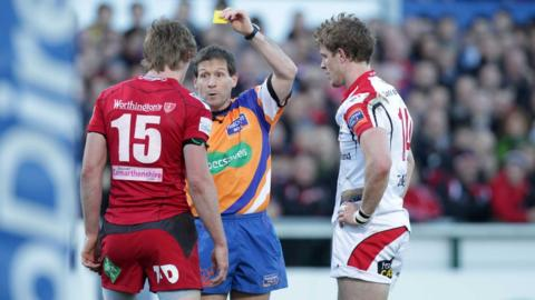 Referee Alain Rolland shows yellow cards to Liam Williams and Andrew Trimble after a first half brawl