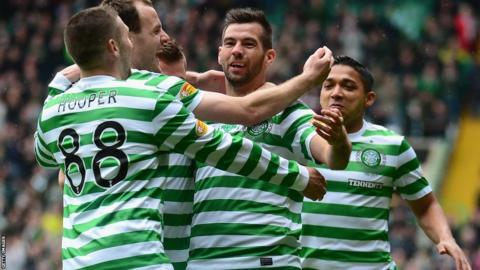 Joe Ledley celebrates one of Celtic's goals as they beat St Johnstone 4-0 in the Scottish Premier League