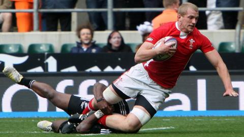 Craig Price of Wales Sevens is tackled in their IRB Sevens Series London leg 45-5 defeat by New Zealand at Twickenham