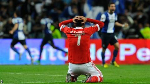 Benfica's Oscar Cardozo shows his disappointment