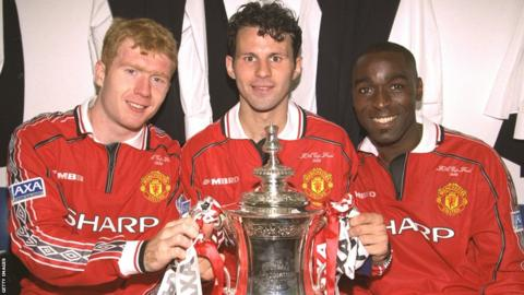 Paul Scholes (left), Ryan Giggs and Andy Cole (right) celebrate winning the FA Cup in 1999