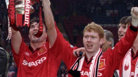 Paul Scholes (right) lifts the FA Cup in 1996 with team-mate Roy Keane