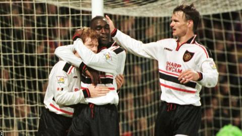 Manchester United's Paul Scholes (left) celebrates scoring a goal with Andy Cole and Teddy Sheringham (right)