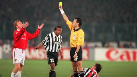 Manchester United's Paul Scholes is shown a yellow card against Juventus during the 1999 Champions League semi-finals