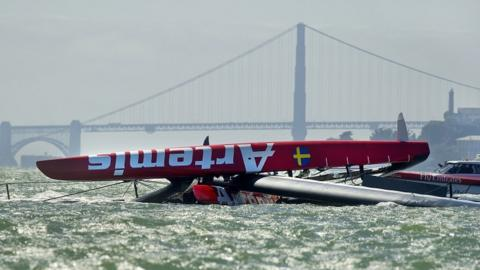2013: British Olympian Andrew Simpson is killed when he is trapped under the upturned hill of his Artemis yacht when it capsizes and breaks up in a training accident in San Francisco on 9 May.