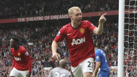 Paul Scholes celebrates scoring against Wigan Athletic