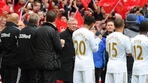 Swansea City's management and players form part of a guard of honour for Sir Alex Ferguson for his last home match in charge of Manchester United