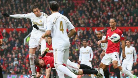 Michu fires in an equaliser for Swansea City against Manchester United at Old Trafford