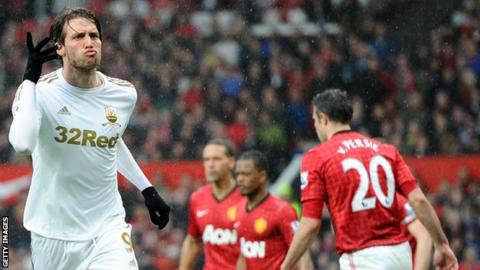 Miguel Michu celebrates his goal against Manchester United at Old Trafford
