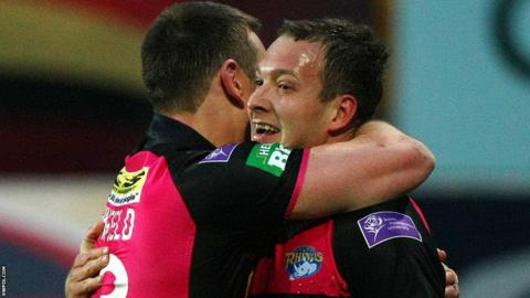 Danny McGuire and Kevin Sinfield embrace after the former's try