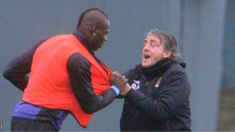 Mario Balotelli (left) and Roberto Mancini