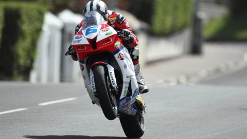 Ballymoney rider Michael Dunlop takes to the air during the Supersport practice session