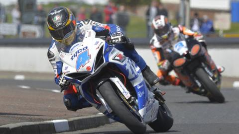 Supersport action with Guy Martin followed by fellow Englishman John McGuinness, who was fastest in practice at 112.00mph