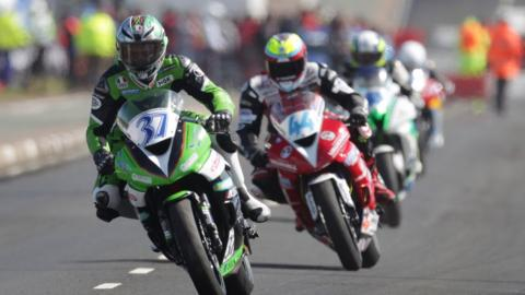 James Hillier leads out a group of riders during Supersport practice