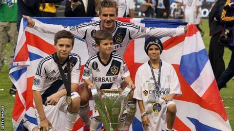 David Beckham poses with his sons Brooklyn Beckham, Cruz Beckham and Romeo Beckham