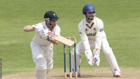 Glamorgan's Mark Wallace hits a shot against Essex as he tops 100 in runs the County Championship clash in Cardiff