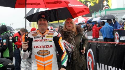 Morecambe rider John McGuinness with his wife Rebecca at the North West 200