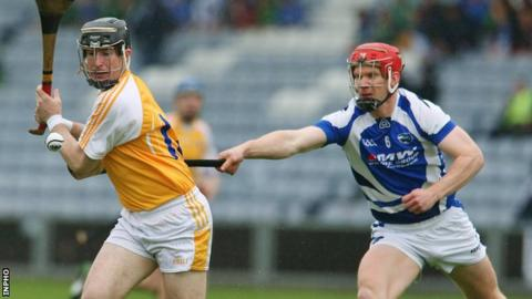 Antrim's Eddie McCloskey in action against Matthew Whelan of Laois