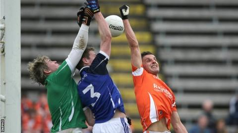 Cavan duo Conor Gilsenan and Rory Dunne battle with Armagh's Stephen Harold in this year's Ulster SFC preliminary round clash
