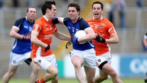 Armagh defender Mark Shields is held off by Cavan's Damien O'Reilly early in the game
