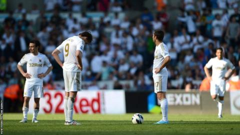 Swansea's players look dejected as they lose their final game of the season 3-0 at home to Fulham
