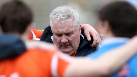 Dejected Orchard manager Paul Grimley talks his players after the surprise 1-15 to 1-11 defeat by Cavan