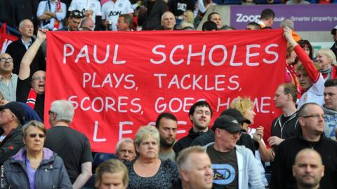 Fans hold up a banner for Paul Scholes