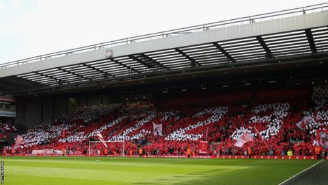 The Kop hold up a tribute to the retiring Jamie Carragher.