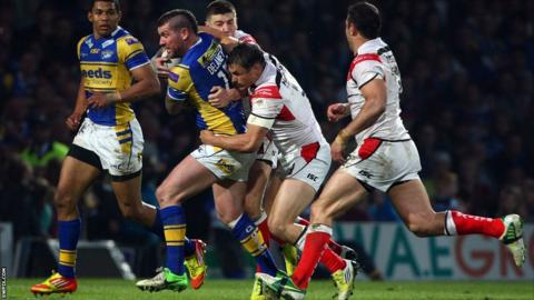 Brett Delaney tackled by Jon Wilkin and Mark Percival