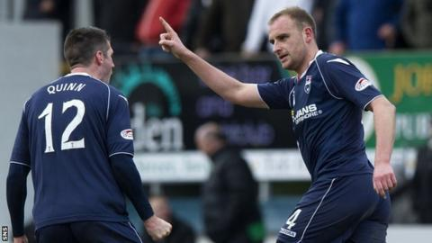 Ross County's Rocco Quinn and Grant Munro
