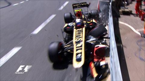 Romain Grosjean crashes his Lotus