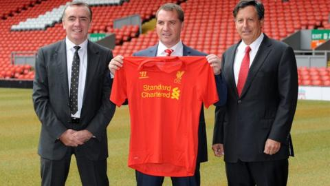Liverpool manager Brendan Rodgers with Chairman Tom Werner and Chief Executive Ian Ayre