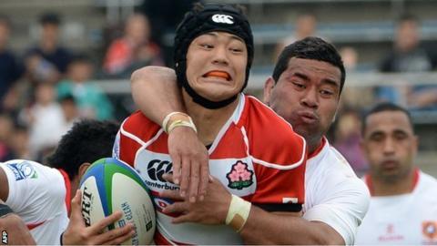 Japan's Yoshikazu Fujita is tackled against Tonga
