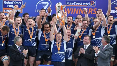 Jamie Heaslip lifts the Pro12 trophy aloft after Leinster's six-point victory at the RDS