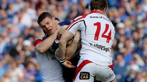 Brian O'Driscoll is stopped in his tracks by Ulster winger Andrew Trimble