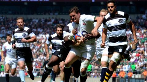 Freddie Burns is tackled for England against the Barbarians at Twickenham
