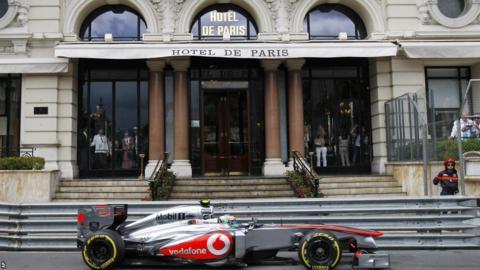 Sergio Perez drives past the Hotel De Paris in Monte Carlo