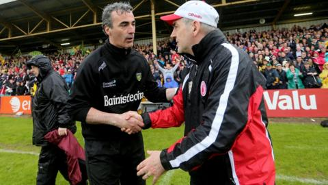 Jim McGuinness and Mickey Harte shake hands after the final whistle at Ballybofey