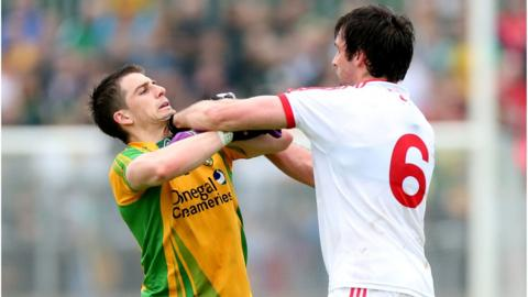 Paddy McGrath and Joe McMahon clash during Donegal's six-point victory over Tyrone