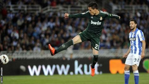 Real Madrid's midfielder Jose Maria Callejon (left) shoots to score during the Spanish league football match v Real Sociedad