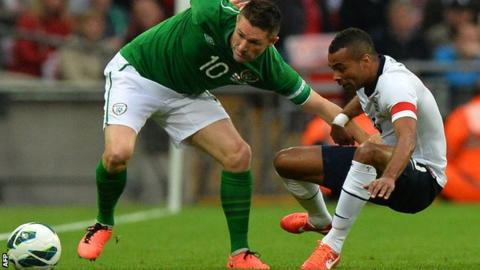 Robbie Keane of the Republic of Ireland in action against England captain Ashley Cole