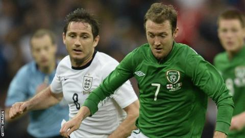 Aiden McGeady (right) in action against England