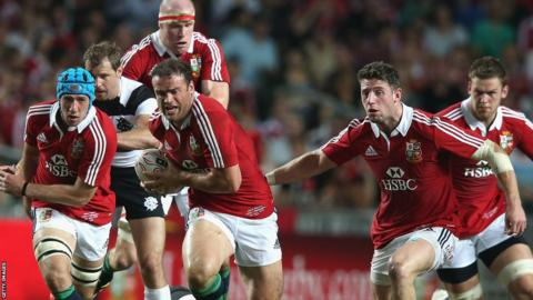 Jamie Roberts tries to take the ball under pressure from Joe Rokocoko as the 2013 British and Irish Lions tour begins against the Barbarians in Honk Kong