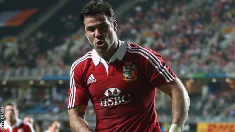 Mike Phillips celebrates scoring in Hong Kong